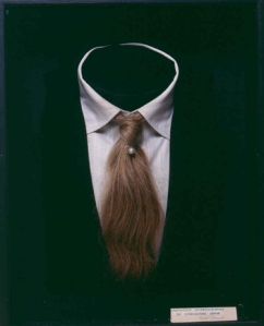 mimi parent, interesting: man/woman with a pearl tie pin
