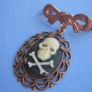 vintage skull brooch